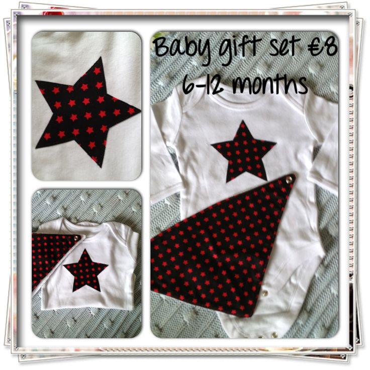 Stars in red on black appliqued bodysuit with matching bandana bib.
