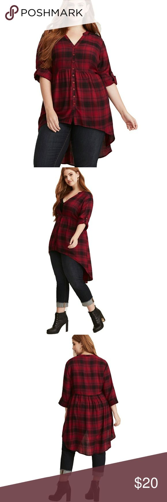 Torrid Plaid Hi-Lo Button Front Tunic It's a top? It's a dress? Nope, it's the perfect in-between and it's your new favorite tunic. The lightweight red and black plaid fabric has repeat quality. The hi-lo hem totally flows on its own, while a button front and tab sleeves polish up the look.  Great used condition! Torrid size 2. torrid Tops Tunics