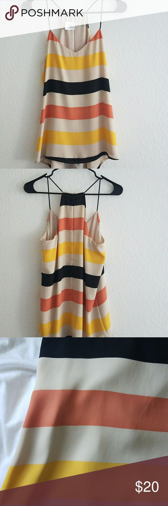 Express Barcelona Cami Reversible cami with orange, yellow, and black wide stripes. The background color is a neutral as well as the reversible side. Size M. Express Tops Tank Tops