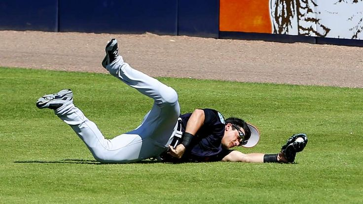 2017 spring training:     Playmaker:    Detroit Tigers center fielder Mikie Mahtook ﴾15﴿ makes a diving catch on a ball hit by New York Yankees' Starlin Castro ﴾not pictured﴿ in the  second inning of a spring training game at George M. Steinbrenner Field in Tampa, Fla., on Feb. 28..