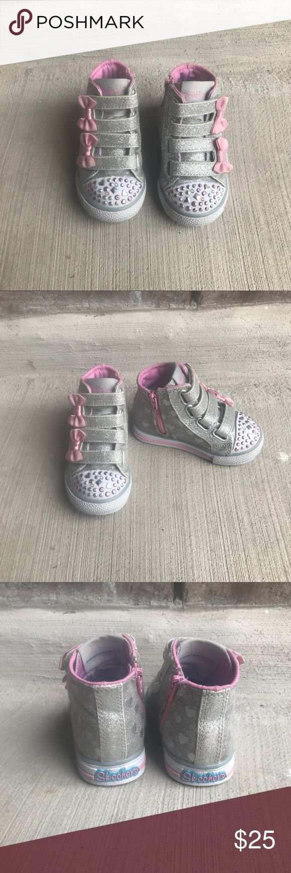 Skechers Twinkle Toes high top Skechers Twinkle Toe high top shoes. Size 5, pink and grey. Zips down on the side for easy insert. Used but still in great condition, lights still light up. Always got compliments on these shoes, very cute! Pet and smoke free home. Skechers Shoes Sneakers