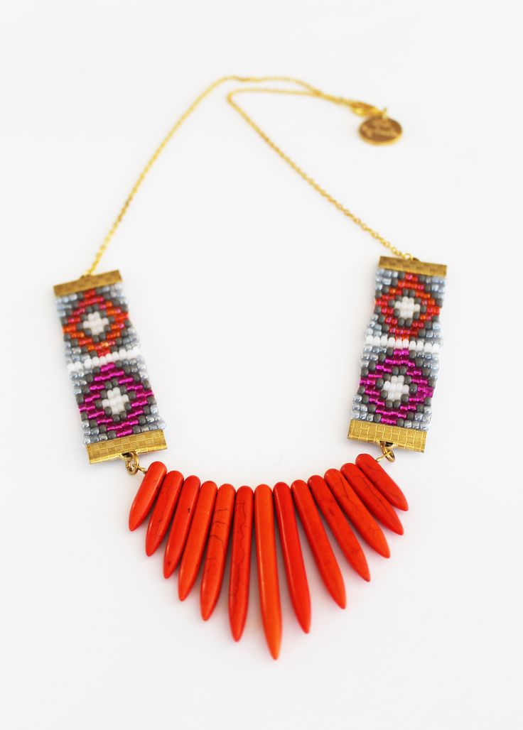 Seed bead Aztec pattern necklace with fine gold chain and bright orange howlite spikes.  Handmade in Wellington, NZ, by Shh by Sadie designer Sadie Hawker. Shhbysadie.com  Spike necklace / aztec jewellery