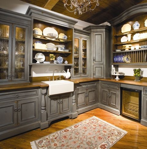 I love the farmhouse sink and the furniture-like cabinetry. Beautiful!
