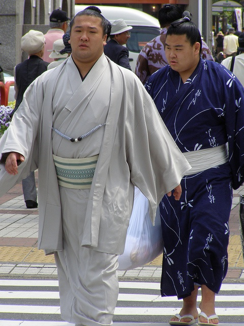 Sumo wrestlers arriving for a sumo tournament at Ryogoku, Tokyo