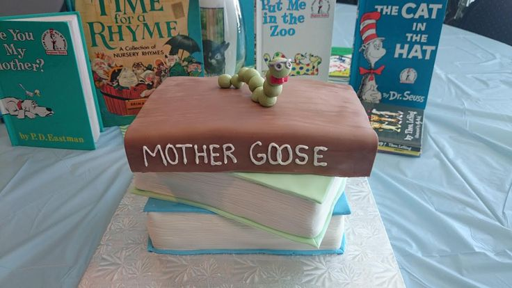 Book themed baby shower cake with a book worm. https://www.facebook.com/caketopiabakerysaskatoon