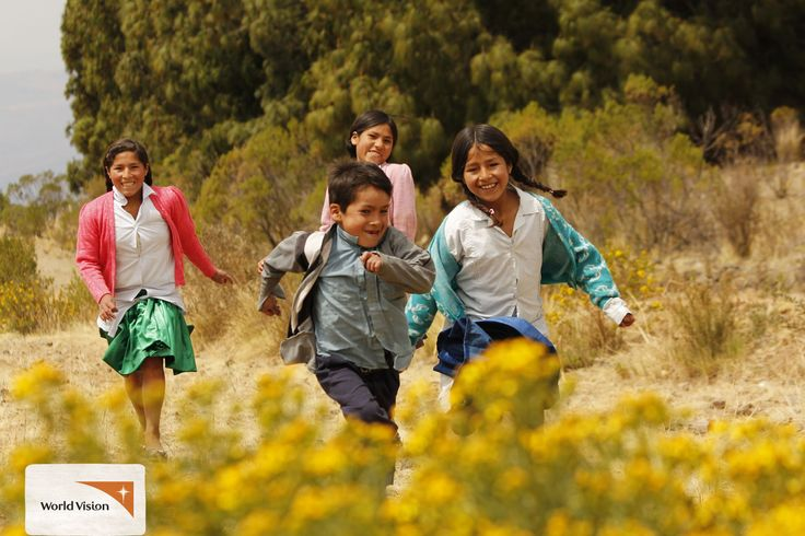 These kids from #Bolivia run and play together on their way to #school! Photo by Jose Luis Roca, #WorldVision