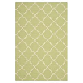 Anchor your bedroom or conservatory with this hand-woven rug, showcasing a trellis motif in light green and ivory. Pair with light wood accents and a statement leather sofa for contemporary appeal.   Product: RugConstruction Material: 100% Wool Colour: Light green and ivoryFeatures: Hand-wovenPile height: 0.64 cm Note: Please be aware that actual colours may vary from those shown on your screen. Accent rugs may also not show the entire pattern that the corresponding area rugs have.Cleaning…