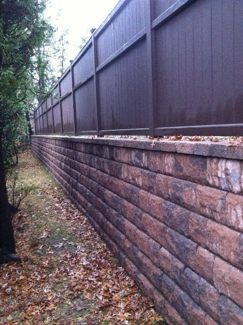 Image result for privacy fence on top of retaining wall sidewalk