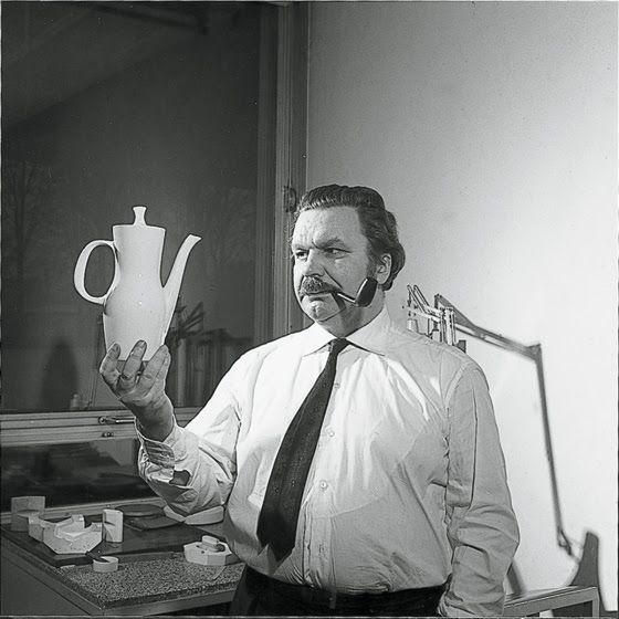 Tapio Wirkkala looking at a pot in the Finlandia series