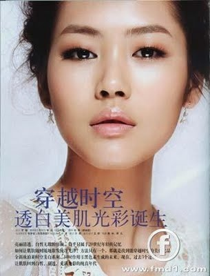 Chinese Model Liu Wen: a face with hooded eyes done very romantically on a dewy face.