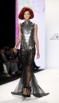 Project Runway 12 WINNER Dom Streater!! LOVE LOVE LOVE this unconventional materials dress in Dom's collection!! So SEXY!!!