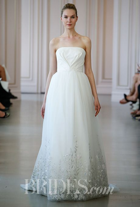 Brides.com: . Strapless silk and tulle ball gown wedding dress with a floral embroidered hem, Oscar de la Renta