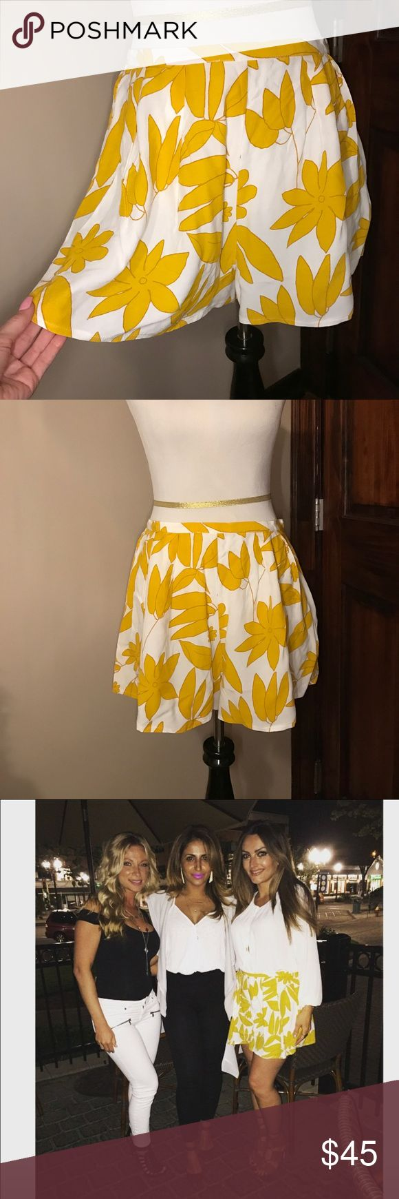 ASOS Floral Culotte Shorts Size US 8.  100% viscose.  Cream with yellow flowers.  Flowy culotte fit.  Slight pleats at top front and back.  Only worn once. ASOS Shorts