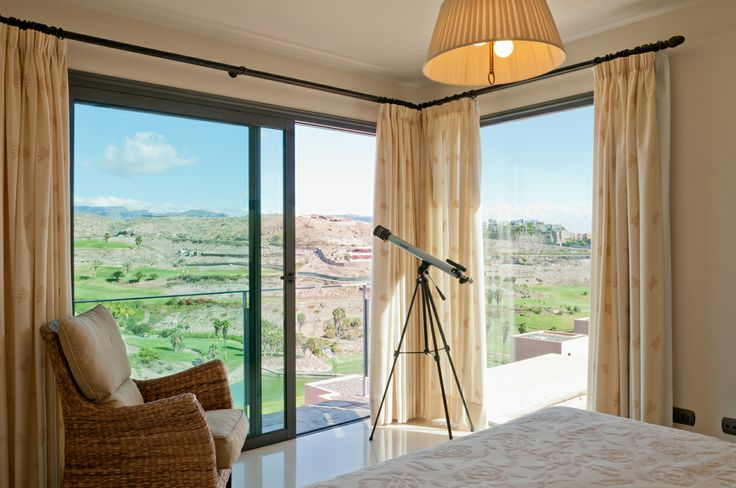 A room with a view. Amazing Bedrooms with a panoramic view of the landscape, the golf course and / or the ocean in villa rentals VillaGranCanaria.com
