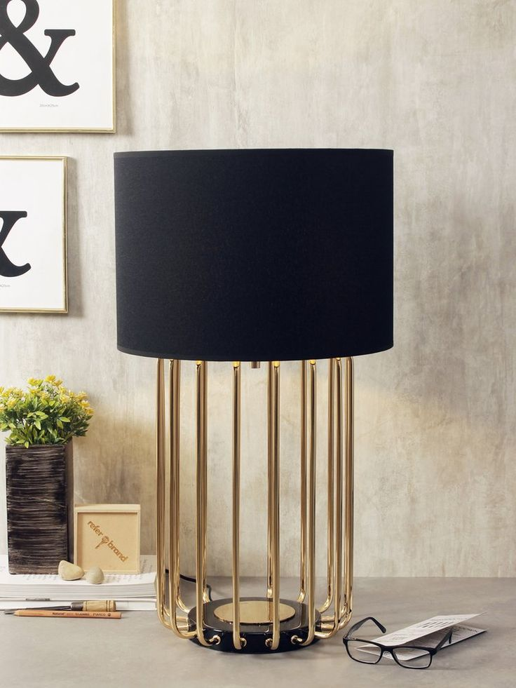 Spencer a striking addition to any home the spencer table lamp boasts a metallic