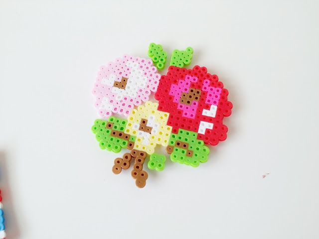 Flowers hama beads (pattern from Cath Kidston needlepoint book) by hopscotch lane