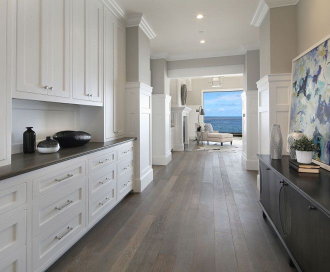 Tall Board and Batten Paneling in Entry HallWhite Cape Cod Beach House Design