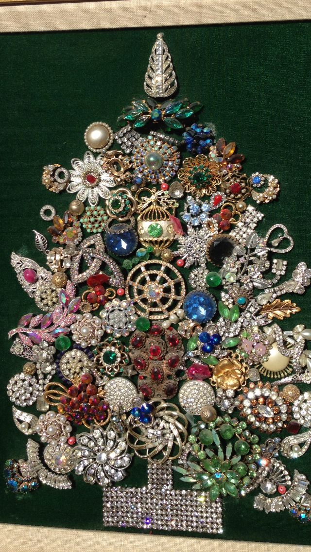 Christmas tree in a frame made with vintage rhinestone pins/brooches. - My mother-in-law made one of these one year. She used all types of jewelry - pins, necklaces, etc, and it was just beautiful. Definitely a holiday favorite.