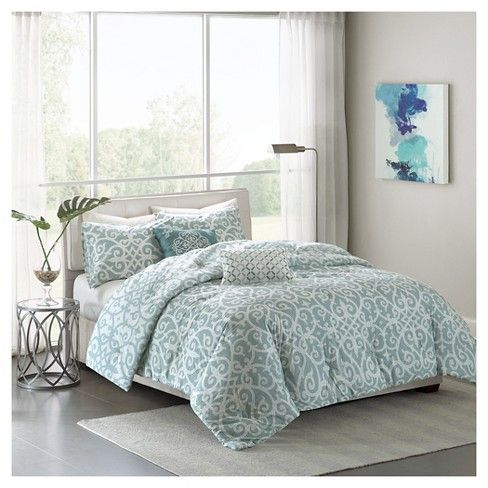 The  Elisa Collection provides an organic look and feel to your space. Featuring an updated fretwork design, this collection is fully reversible with a textured aqua base and off white motif flipping to a textured grey reverse and aqua motif. Printed on 200 thread count cotton, this set includes a reversible comforter, two reversible shams and two decorative pillows.