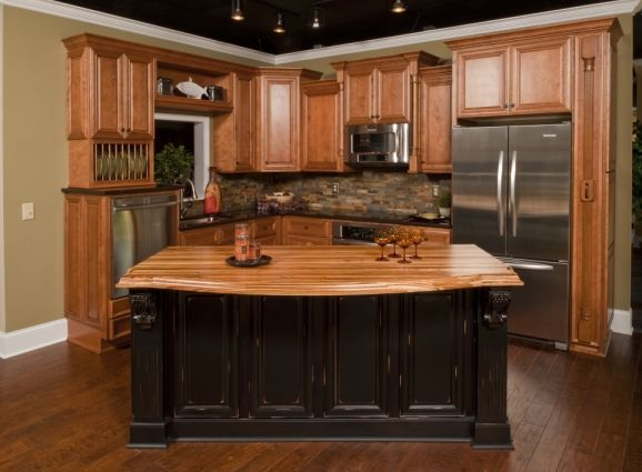 Honey oak kitchen cabinets like the stone backsplash for Dark oak kitchen cabinets