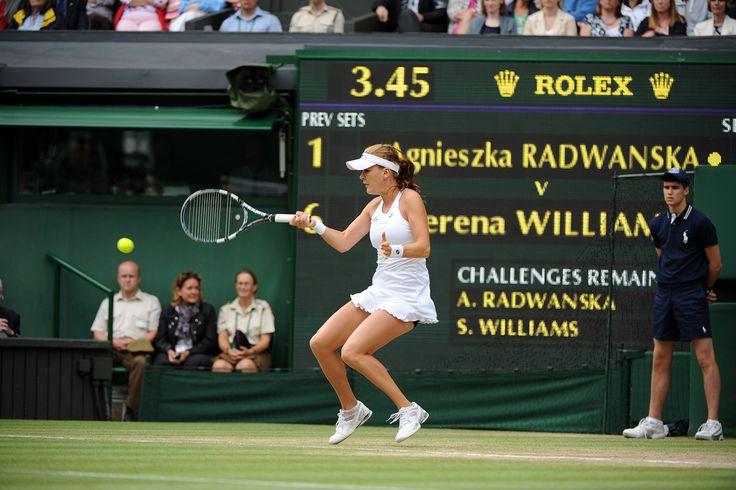 Agnieszka Radwanska tracks down a shot from Serena Williams during the Ladies' final.  Wimbledon 2012.