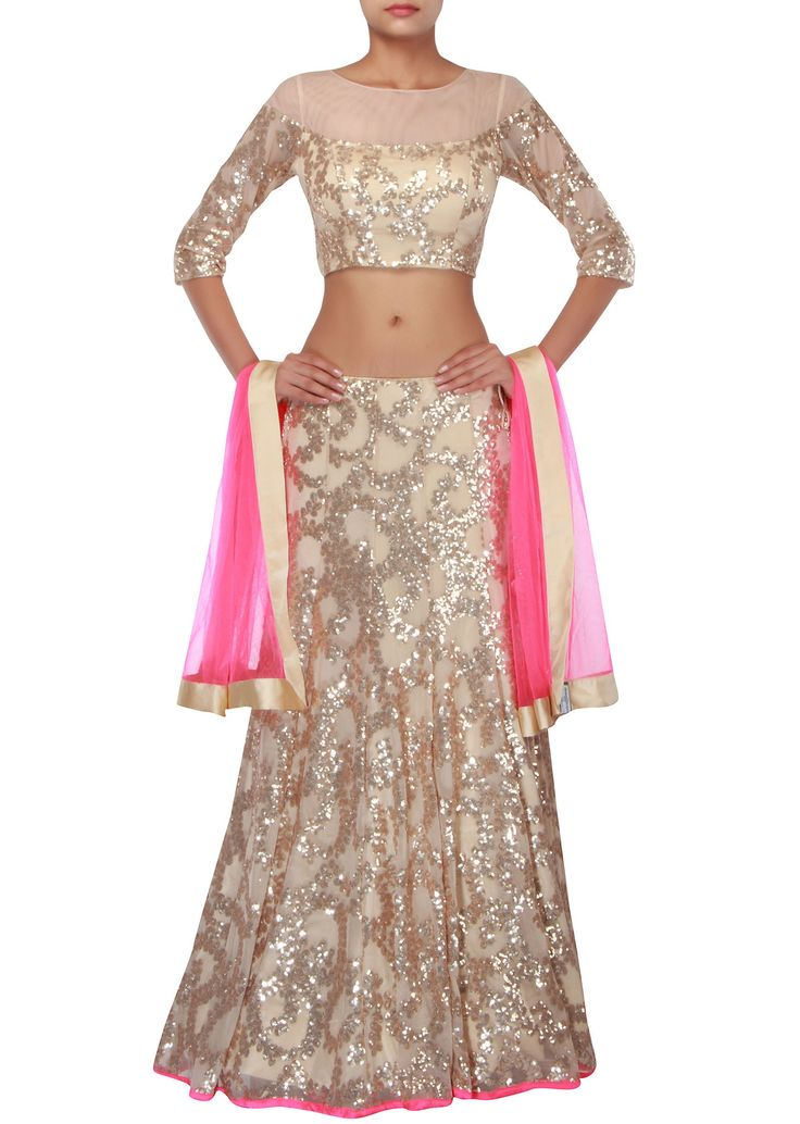 Beige lehenga feautring in net  Its enhanced in sequin embroidery all over  Matched with ready blouse in beige net and dupatta in pink net  Slight variation in color is possible  95% of our customers believe that the product is as shown in the website.