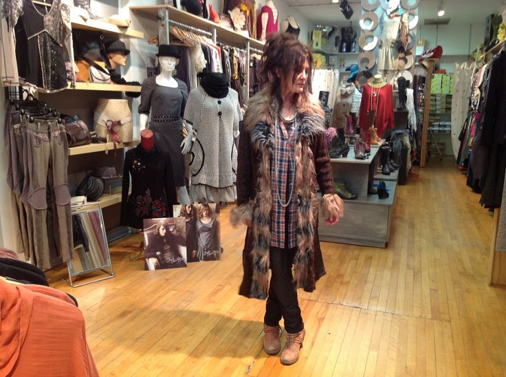 Di.. wearing a cool sweater coat that she sold to the Zellots drummer's girlfriend later that day..