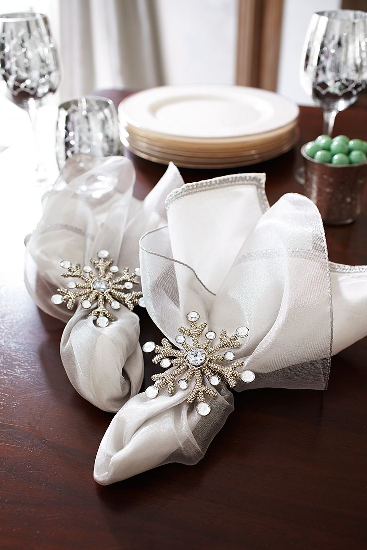 Christmas celebrations may be over, but it's still winter. Let your New Year's Eve table glisten with a dusting of snow-inspired sparkle. Bright white and sheer silver napkins bundled with Beaded Snowflake Napkin Rings from Pier 1 should do the trick.