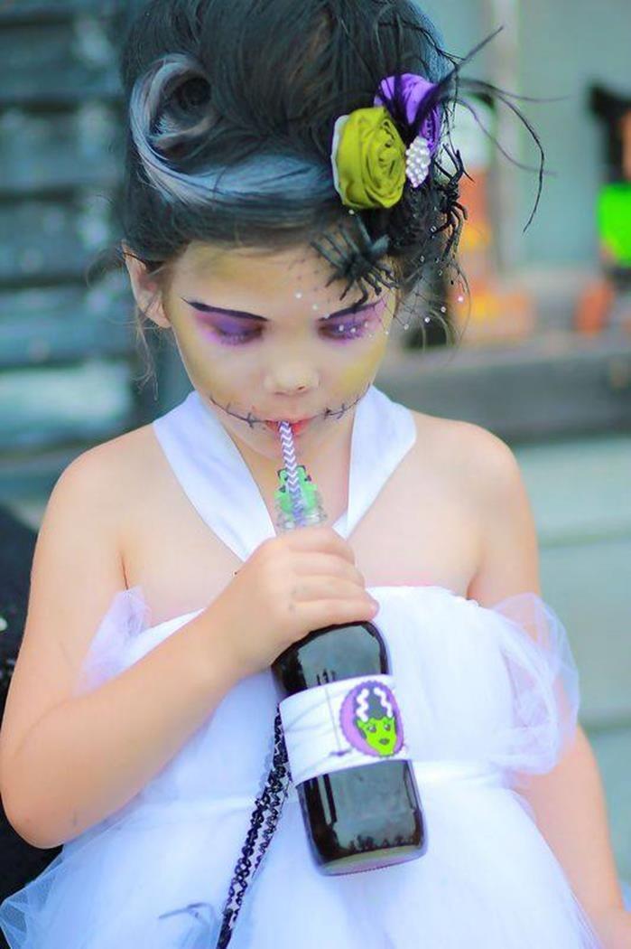 Frankensteins bride costume! love her hair piece! Holy Monster'mony Halloween Party with SUCH CUTE IDEAS via Kara's Party Ideas | KarasPartyIdeas.com #MonsterBash #MonsterWedding #Halloweenparty #frankensteinparty