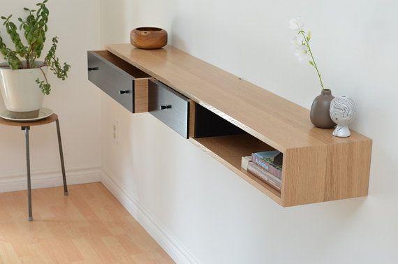 Nous utilisons le chêne blanc solide trimestre scié pour les tiroirs et lextérieur de notre table de console flottante à la main. Les façades sont