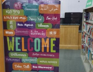 STRATEGY: Multilingual Welcome sign at Harold Washington Library's improved English-language learning space. I will be visiting this library next fall to visit their media space for youth. I will also visit this space in the literature collection to see how they've accommodated English language learners as described in the article.