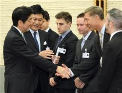 Japanese Prime Minister Shinzo Abe greets oDesk CEO Gary Swart and the other speakers from the Japan New Economy Summit (from left to right): Hiroshi Mikatani of Rakuten, Ben Silbermann of Pinterest, Brian Chesky of Airbnb, Derek Collison of Apcera and Jason Goldberg of Fab.com. The summit focused on ways to create growth in the Japanese economy through innovation, entrepreneurship and a global mindset.