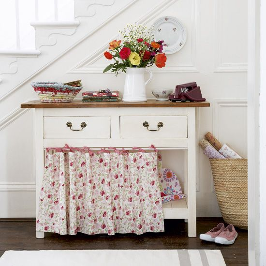:) what a sweet little table.  clever storage for reusable shopping bags, umbrellas, mittens, etc in entryway. It would be perfect with a small closet on either side.