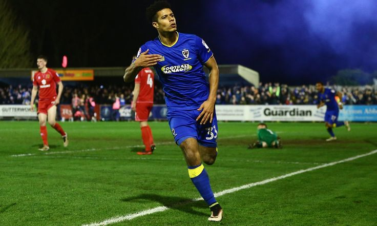 Second-half goals from Jake Reeves and Lyle Taylor gave AFC Wimbledon a 2-0 win over MK Dons that lifted Neal Ardley's team further ahead of their most disliked opponents