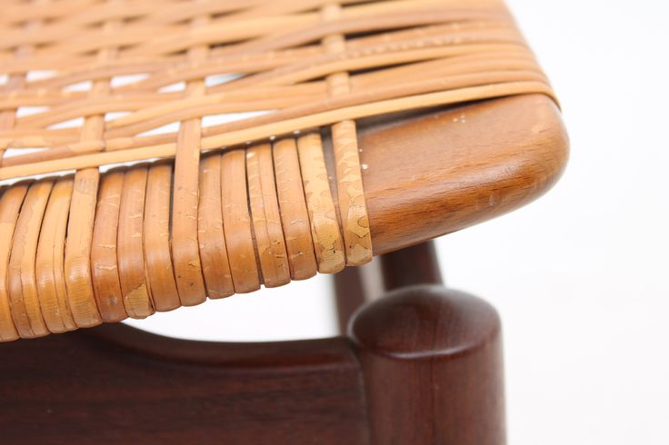 Detail of a teak stool with cane seat. Designed and produced by Ølholm Møbelfabrik, Denmark. www.reModern.dk