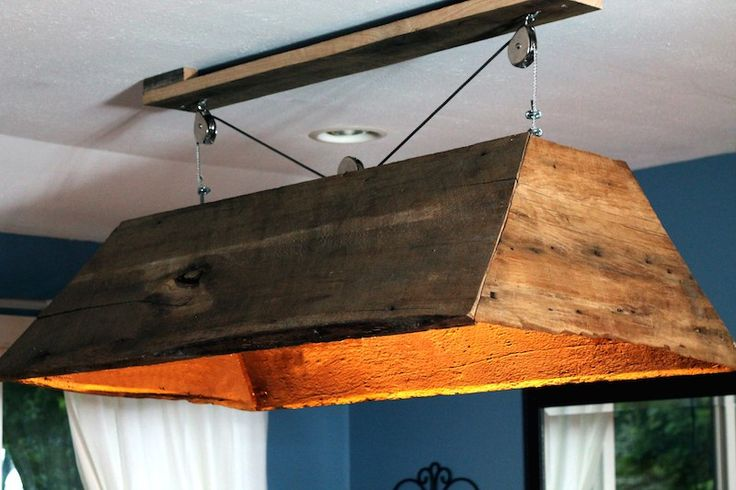 Rustic light fixture made from reclaimed barn wood. #Hipcycle