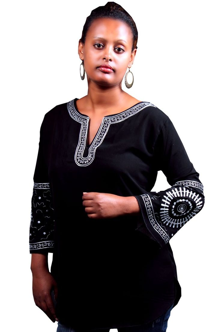 In'ayahAfrican ladies exclusive Haute Couture top featuring beautiful chain stitch hand made embroidery. Special patterns, no two are the same, on the bell hands, and around the neck and back of the neck.
