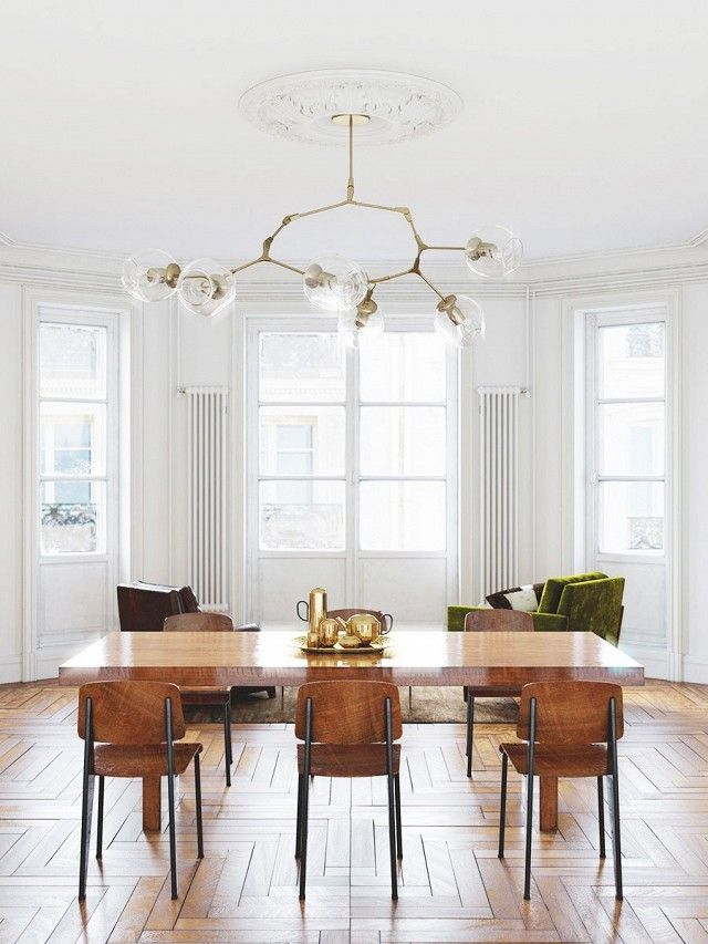 dining space with architectural detailing a modern chandelier and jean prouv dining chairs - Contemporary Dining Room Chandeliers