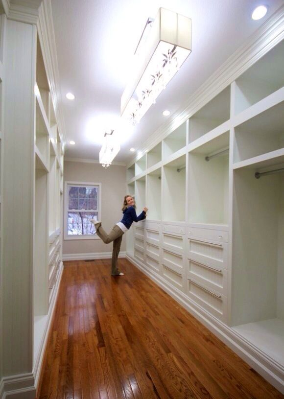 First off...who has enough clothes to fill a closet like this? I do love the closet space though!