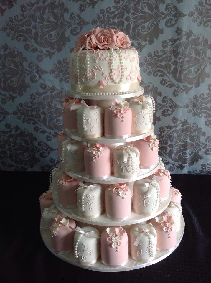 Pretty pink and white mini cakes.