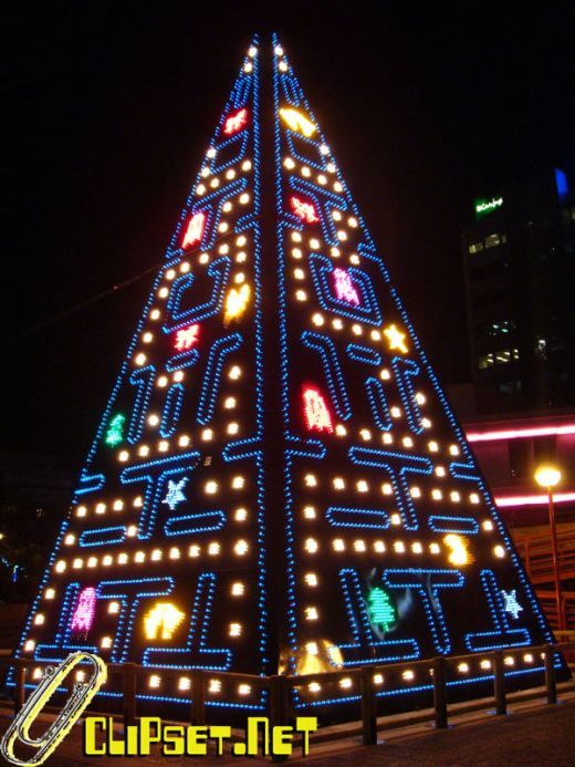 """Coolest Christmas tree ever - Pac-Man and his ghostly pals have been reproduced in this giant holiday light display. The """"tree"""" features a fully-animated version of the classic arcade game, rendered across thousands of colored LEDs."""