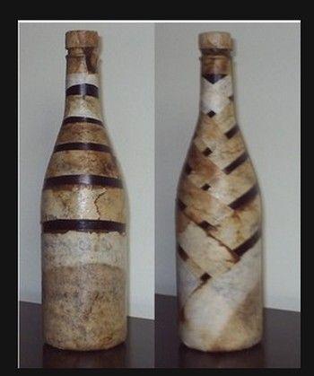 Filtros de café, usados, delicadamente trançados numa garrafa de champanhe vazia...ficou lindo, tanto na parte da frente como no verso...  S...