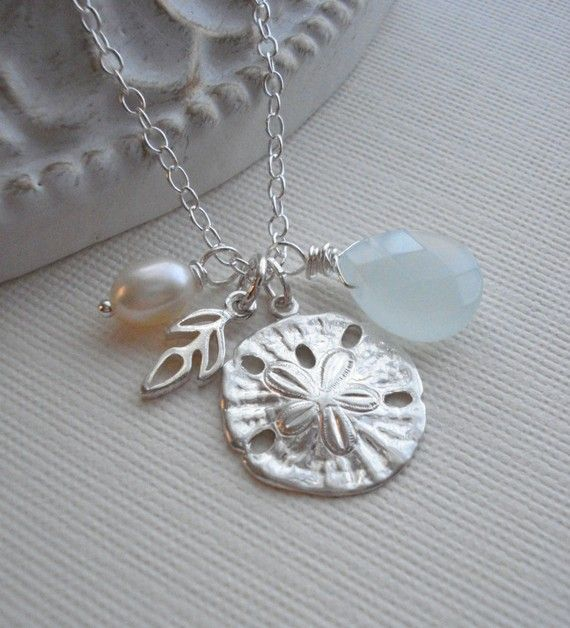 Silver sand dollar necklace.
