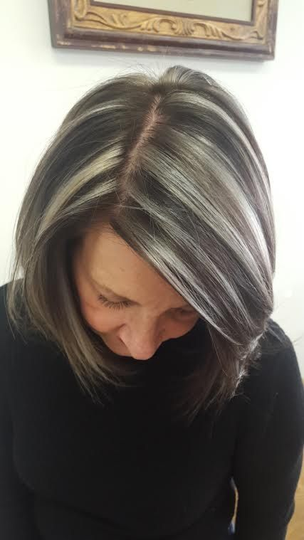 Wanda White-Ouellette, 58 of Bangor, decided to stop hiding her gray and instead enhance it with chunky swaths of silver.