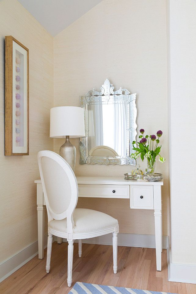 East Hampton Beach Cottage - Master Bedroom Vanity Area: A Venetian mirror and artwork with sea urchins displayed on the wall. Louis style chair and white vanity adds a special touch to this feminine space.