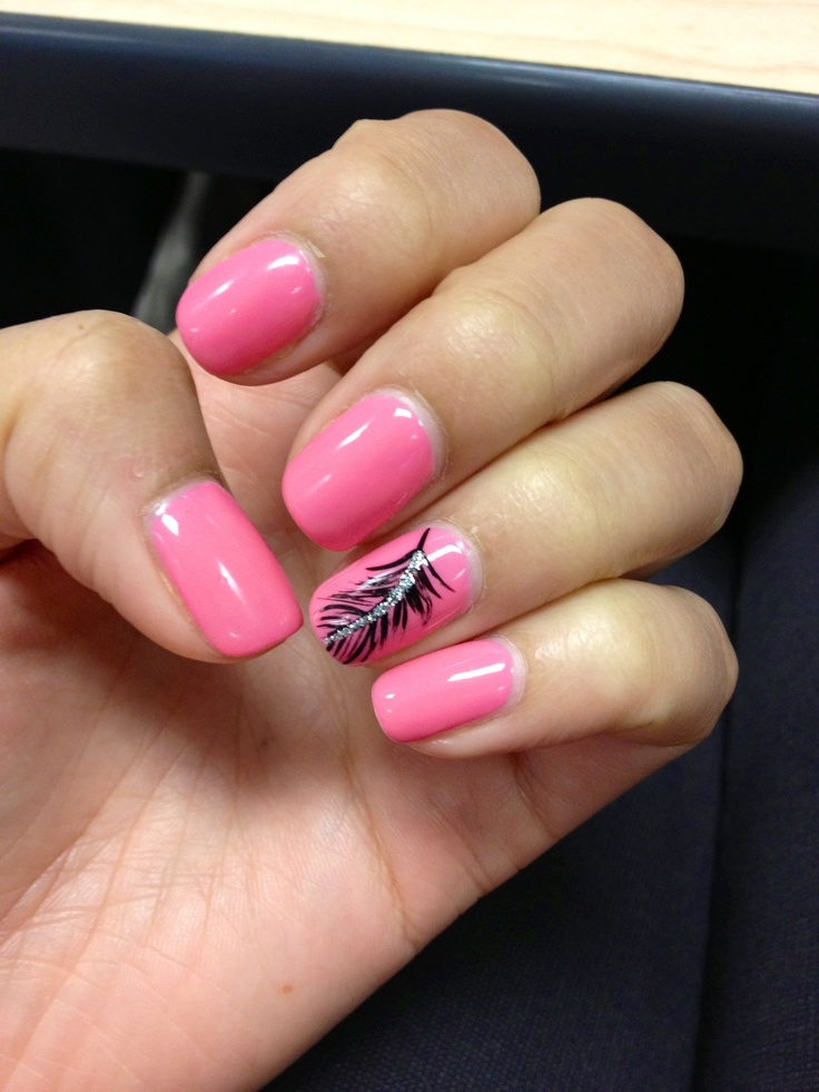 Pink shellac nails with feather design on ring fingers.