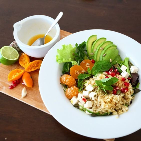 lunch: quinoa salad with avocado, feta, seeds, pomegranate, mint, mandarin, sprouts dressed with…