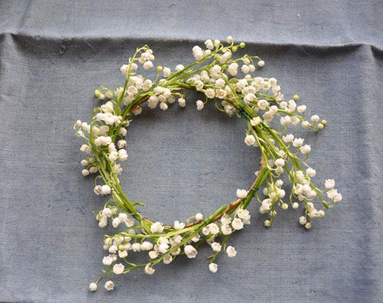 love love love. Lily-of-the-Valley = my most favorite flower in the world. What better to have than a lily-of-the-valley crown :)