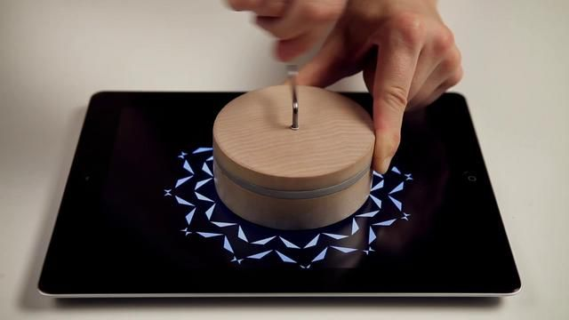 Little Boxes is a music box concept for iPad. It consists of a tangible part composed of three separate music boxes that interact with an iPad and an application. When placing one of the boxes on the iPad, it recognizes it and activates. The idea is that each box contains its own universe revealed by the action of the crank with an animation and melody proper to each.