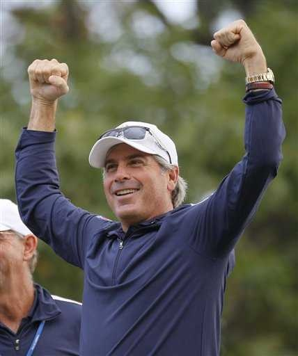 Fred Couples tries to get the crowd going on the first tee at the Ryder Cup PGA golf tournament Wednesday, Sept. 26, 2012, at the Medinah Country Club in Medinah, Ill. (AP Photo/Charles Rex Arbogast)